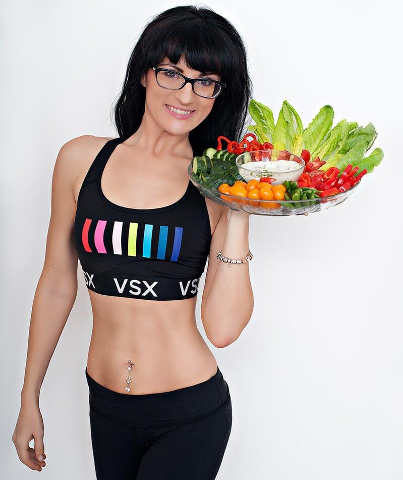 Melissa Raimondi holds a vegetable platter with dip