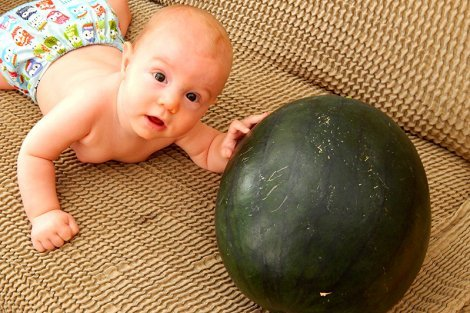 The Cech baby beside a watermelon