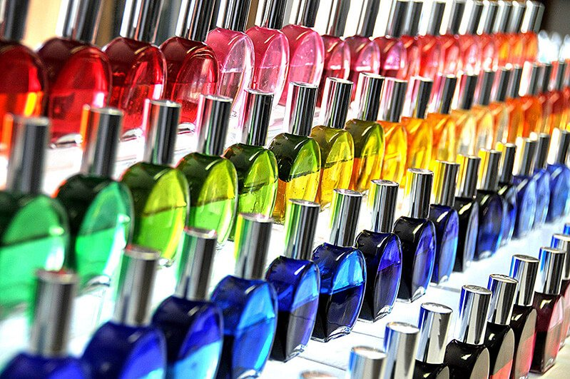 Closeup photograph of colored oils and essences