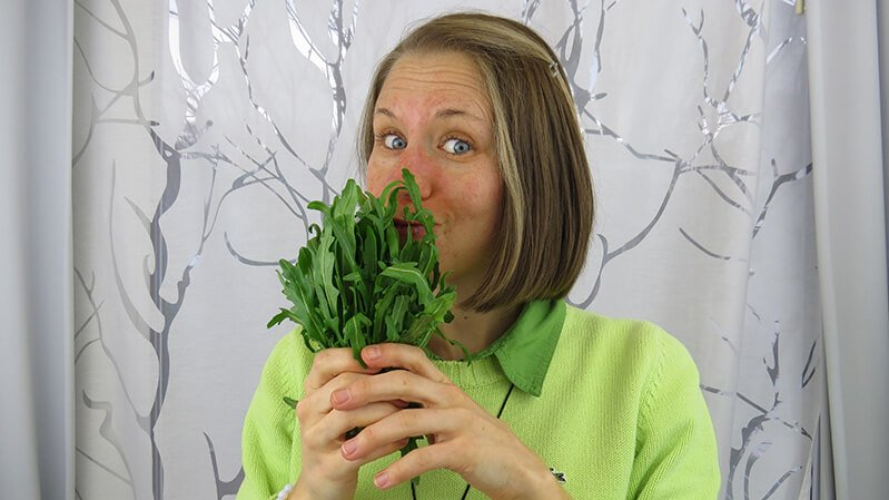 Eva Straub holds dandelion in front of her face