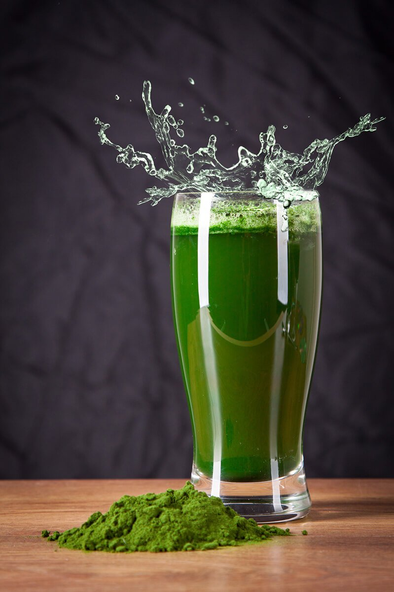 A glass of barley grass juice powder mixed with water