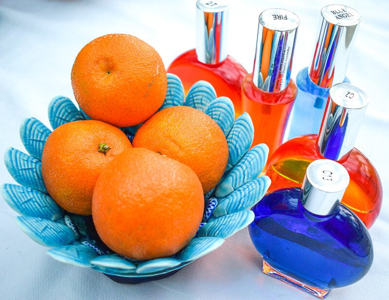 Oranges in a blue bowl with orange and blue Color Mirrors