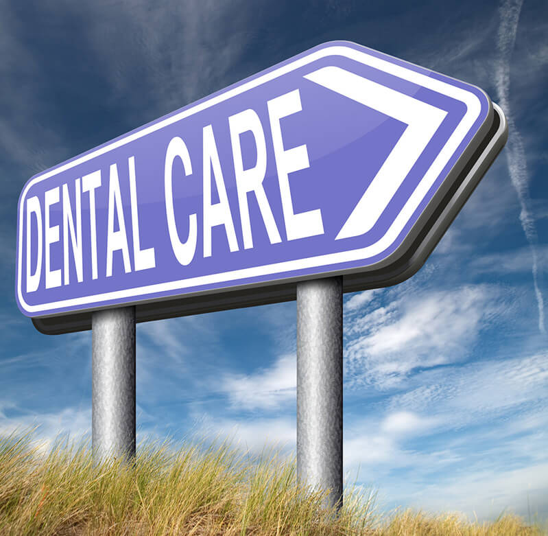 "A road sign says ""Dental Care"""