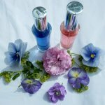 The Color Mirrors Starlight Magic and Starlight Innocence with flowers on white background
