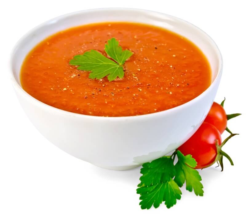 Essential oils of basil added to a bowl of tomato soup