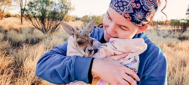 Brooke Reynolds holds a kangaroo