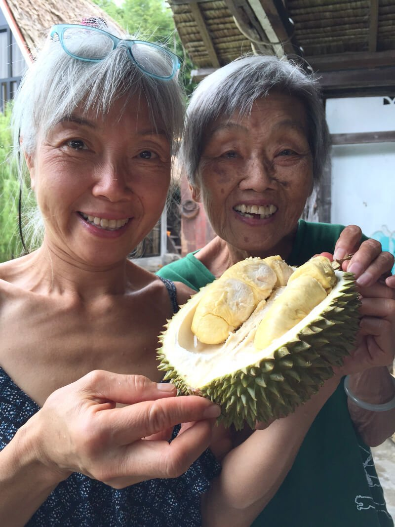 Ping Chan holds durian with her mother