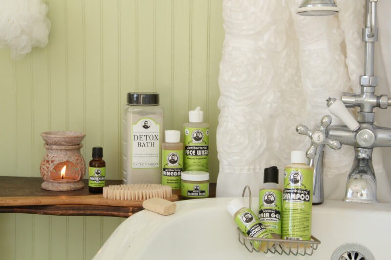 Uncle Harry's Natural Products for bathing and detoxification photographed beside a bathtub and shower