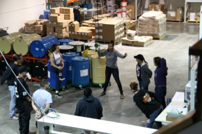 Uncle Harry's Natural Products staff members work in the company's warehouse