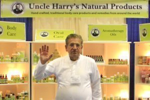 Uncle Harry's Natural Products founder Harry Terhanian waves while at a product stand