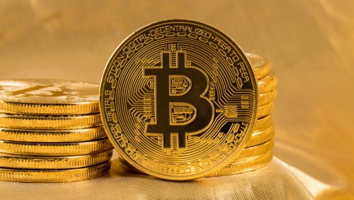 Cryptocurrencies - Bitcoin - standing and stacked on gold background - Fruit-Powered
