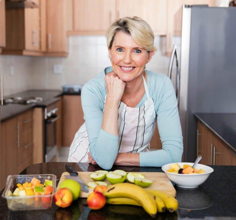 Middle-age woman prepares fruit recipes