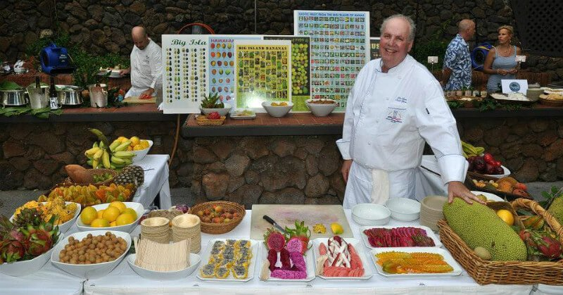 Ken Love at an exotic fruit station, containing some of the choicest fruits