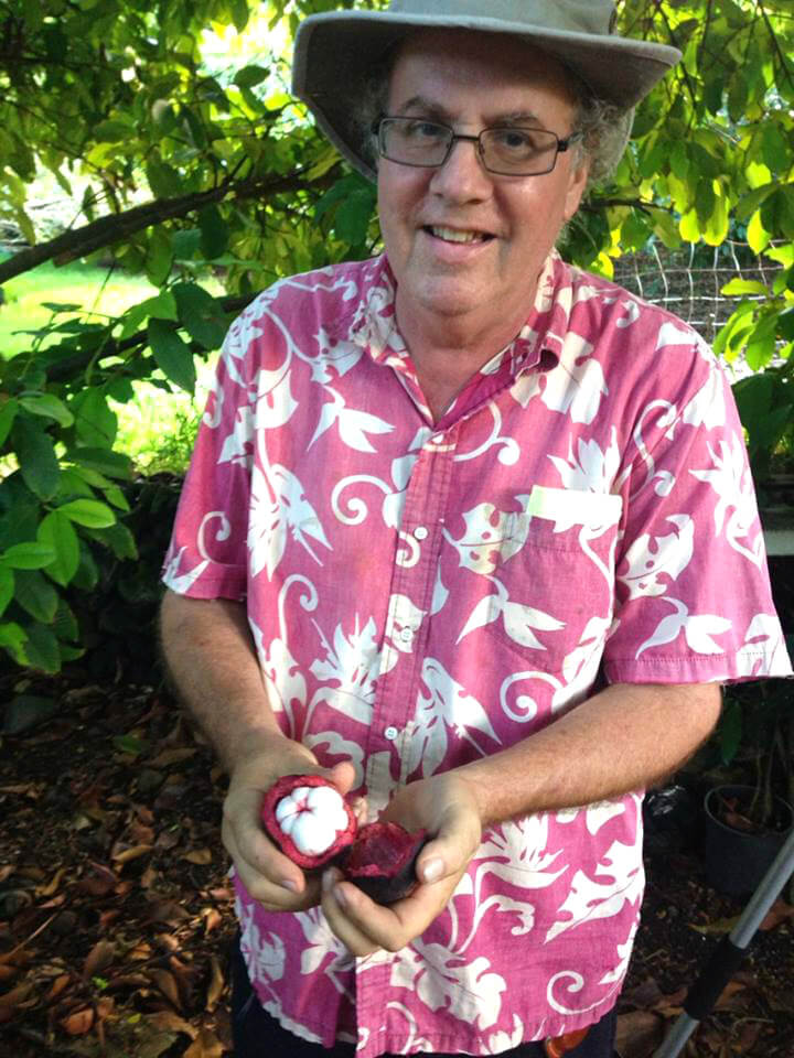 Ken Love holds fruit in August 2014