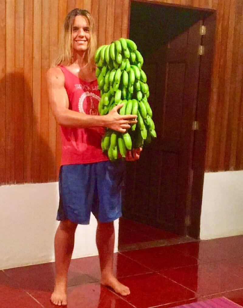 Nicolas Dudet holds dozens of bananas