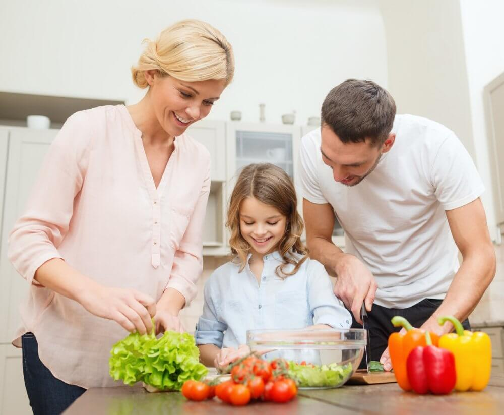 Diet Guide - Fruitarian Diet - Fruit Diet - Low-Fat Raw Vegan Diet - Family Preparing Salad In Kitchen - Fruit-Powered