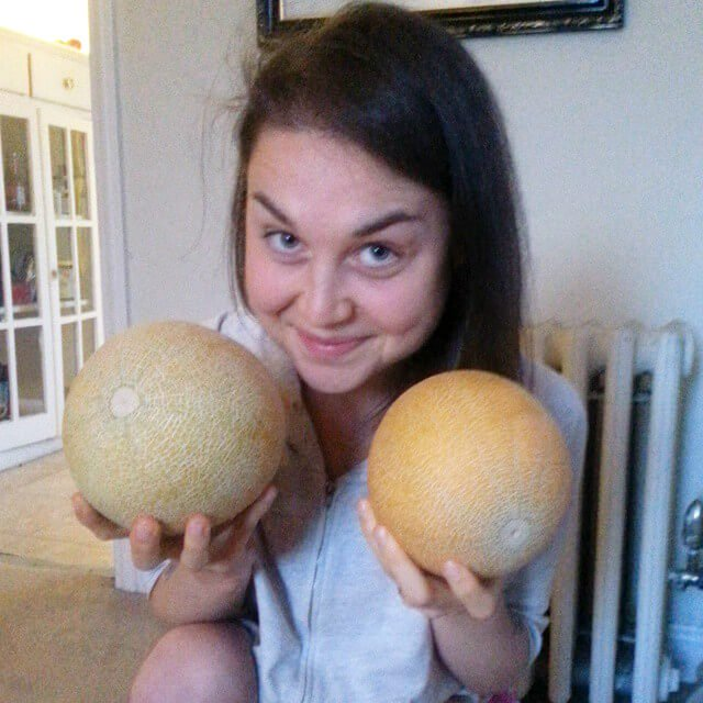 Aliyah Washington holds cantaloupes - Tips for Transitioning to a Raw Food Diet Intelligently