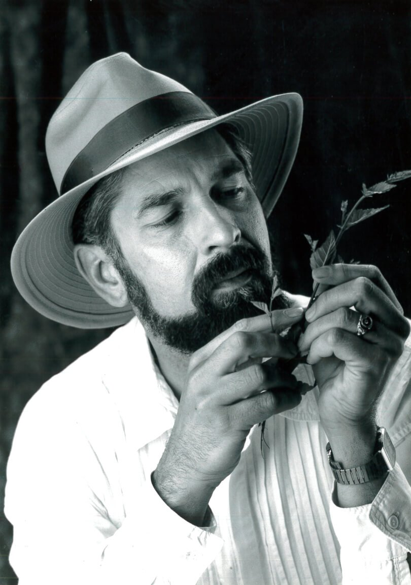 David Christopher inspects healing herbs for health