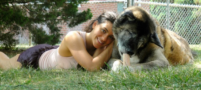 Michelle Jolene with dog Kaya on grass - everlasting love - afterlife message