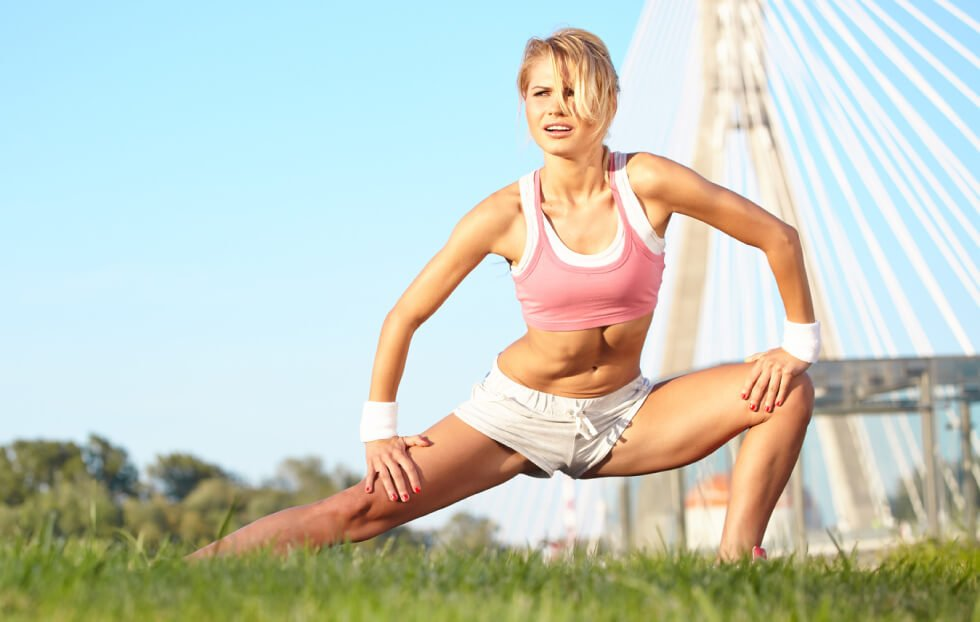 Blonde woman stretching outside - Posture Exercises Method - pain relief and peak performance - Fruit-Powered