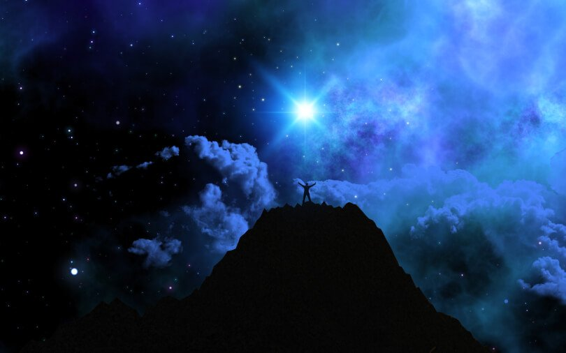Dark night of the soul - emotional release - man summiting mountain at night under stars - Fruit-Powered