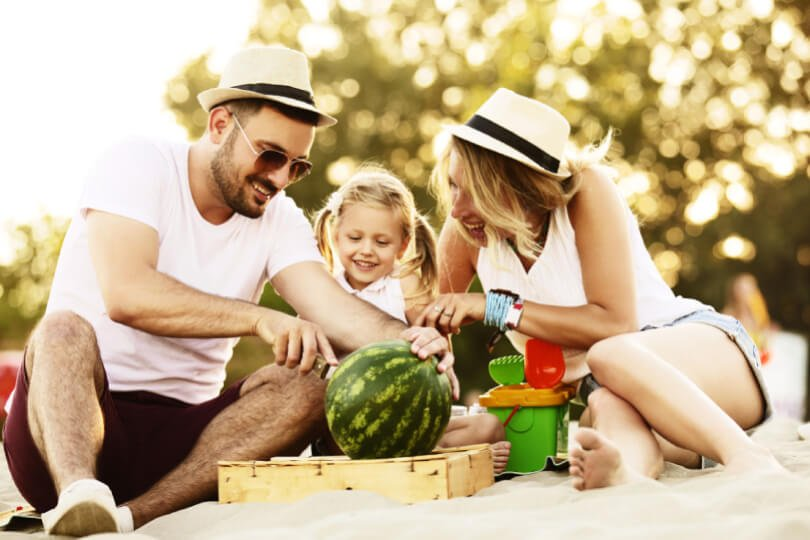 Father, mother and child with watermelon - Fruit-Powered