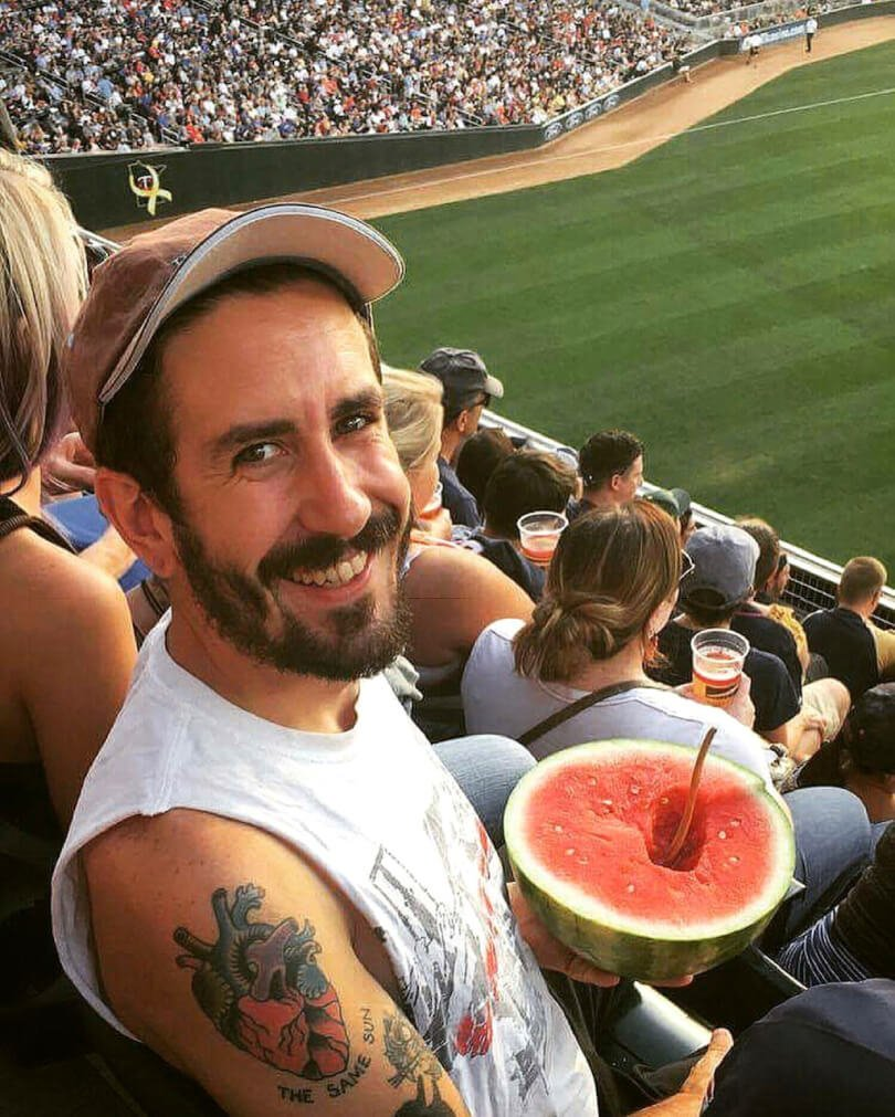 TJ Long eating watermelon at a baseball game - Raw Vegan Transformations - Fruit-Powered