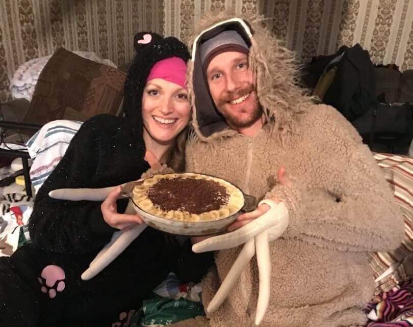 Chris Kendall and Kamilla Jonvik holding food and wearing animal onesies - Fruit-Powered