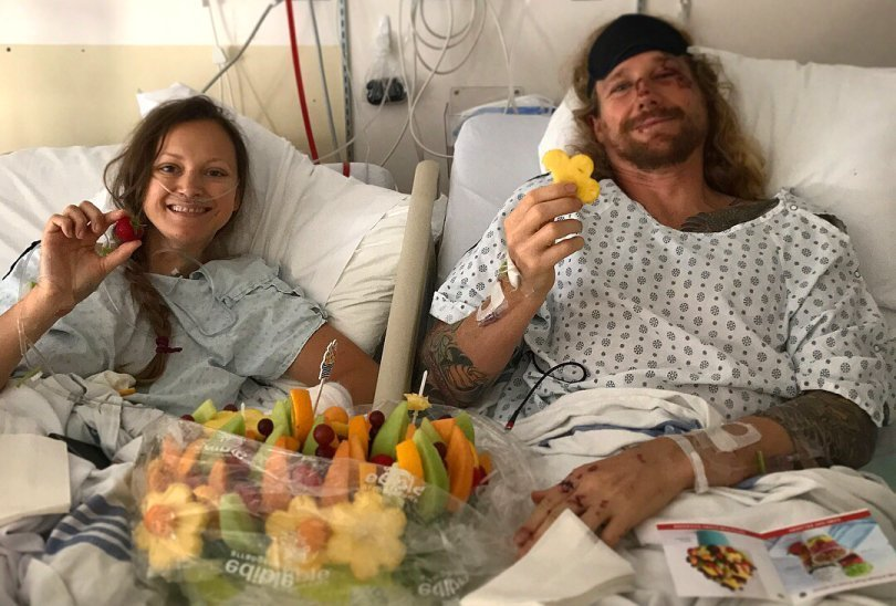 Chris Kendall and Kamilla Jonvik holding fruit in a hospital - Fruit-Powered