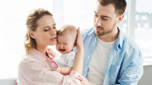 Why is my baby so fussy - mother and father with fussy baby - Gillespie Approach–Craniosacral Fascial Therapy - Fruit-Powered