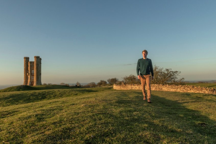 Raw Vegan Tips for creating a life you love - Jack Childs - walking with castle in background - Fruit-Powered
