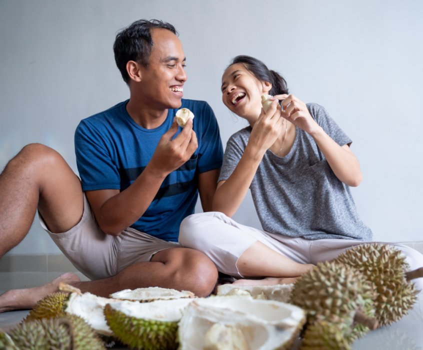 Asian people eating durian - Fruit-Powered
