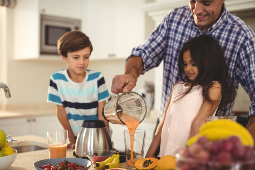 Healthy school lunches - father, son and daughter making fruit smoothie recipes - Fruit-Powered