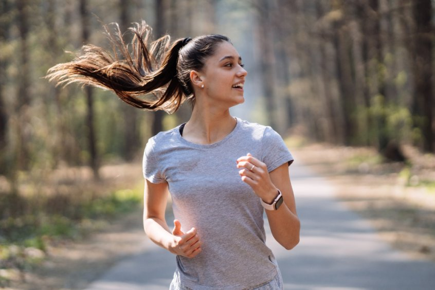 Woman running in a park - Fruit-Powered