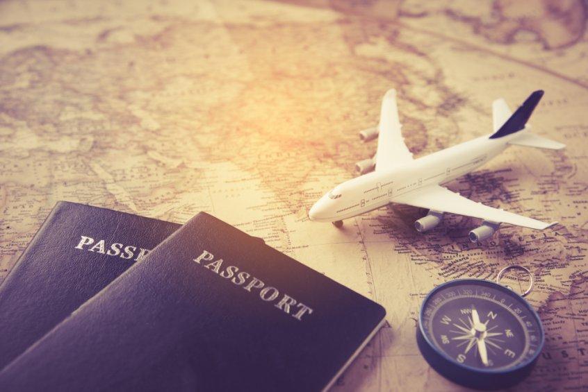 Coronavirus travel vaccinations - passport, plane, compass and map - Fruit-Powered