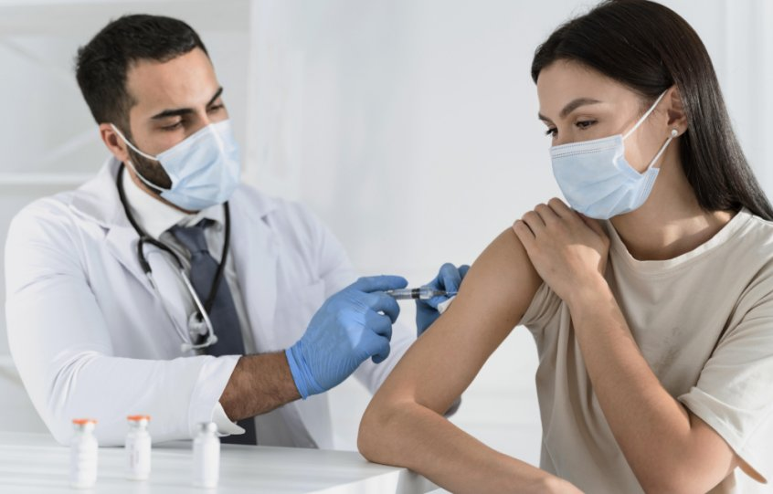 COVID vaccine - doctor injects woman - Fruit-Powered