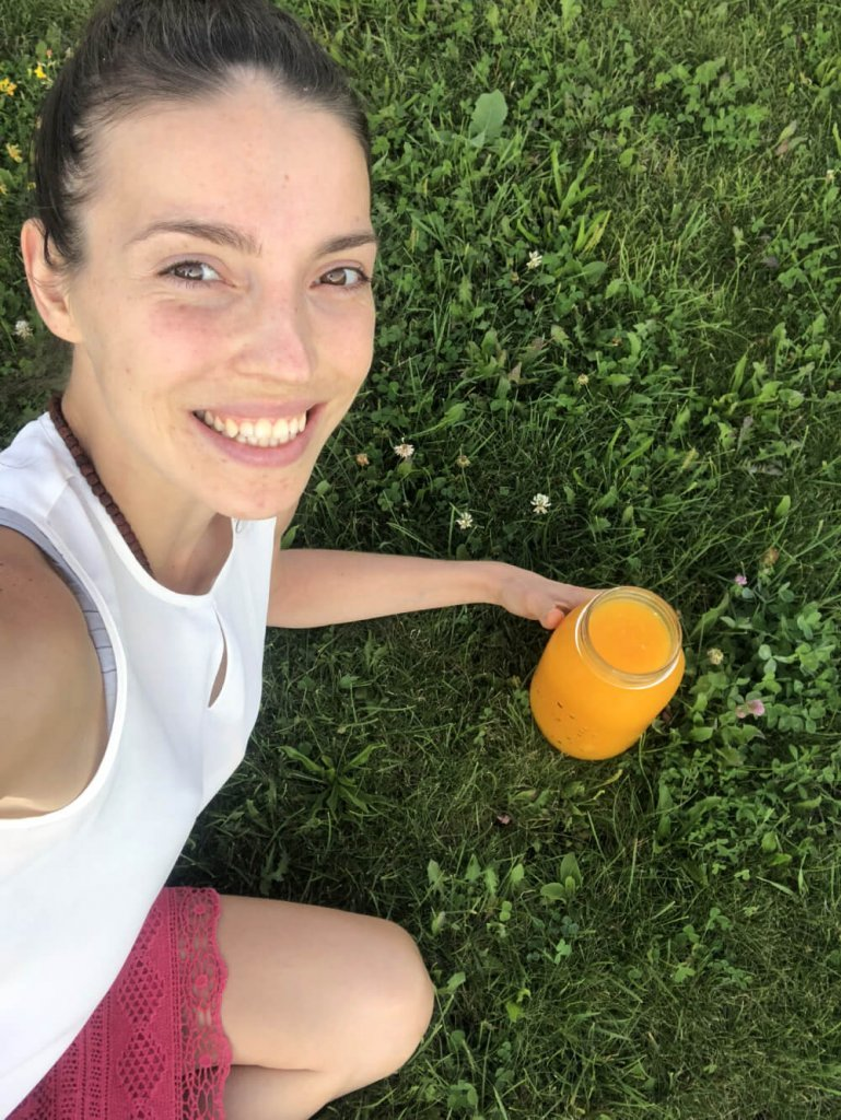 Kristina Poudyal - on juice fast - relaxing on grass - Fruit-Powered