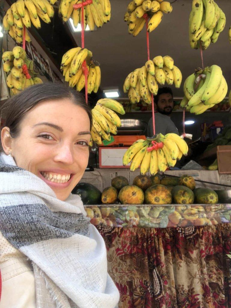 Kristina Poudyal - with bananas - Nepal fruit market - Fruit-Powered