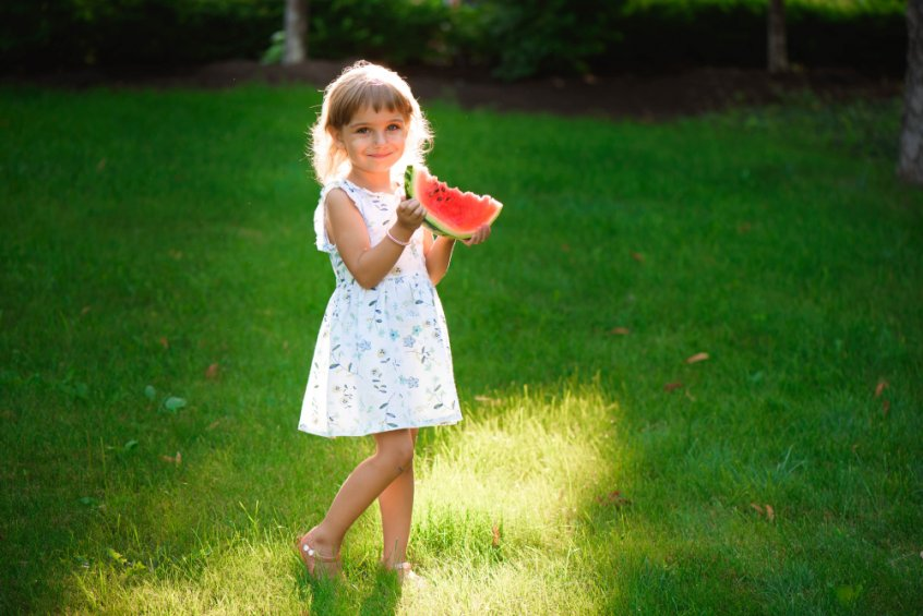 Nature's laws - girl holding watermelon wedge - Fruit-Powered