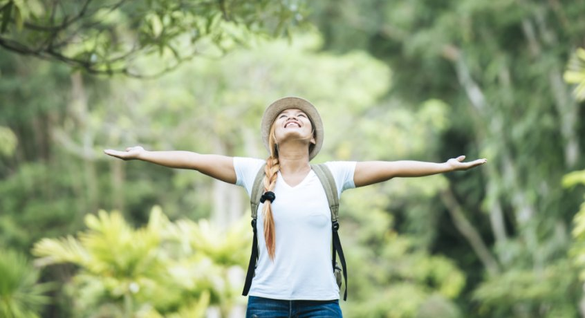 Nature's laws - woman with arms outstretched in nature - Fruit-Powered