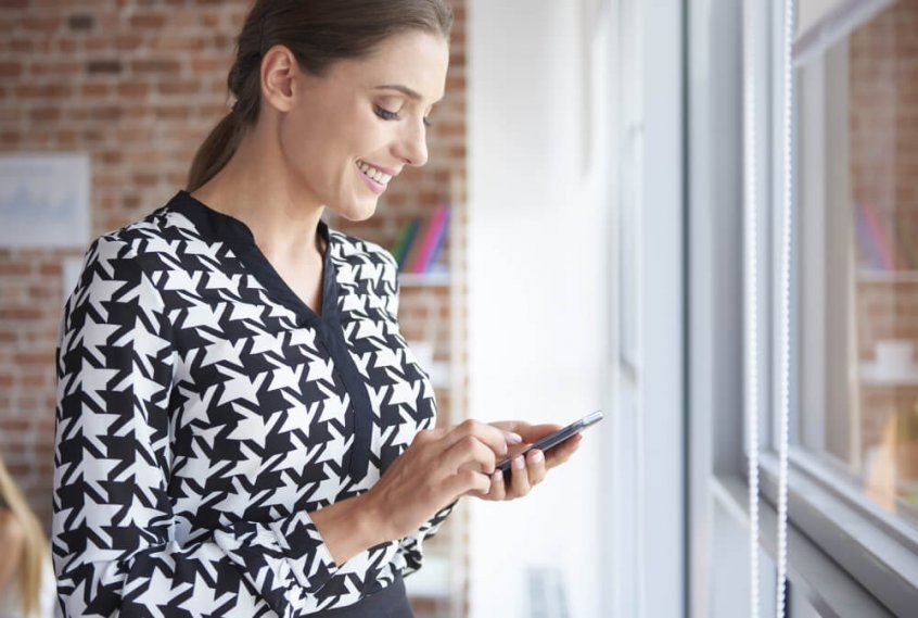 Text neck - woman using smartphone - Fruit-Powered