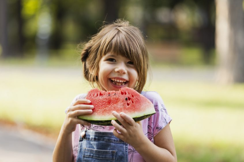 Autism symptoms and causes - healing autism naturally - girl eating watermelon - Fruit-Powered