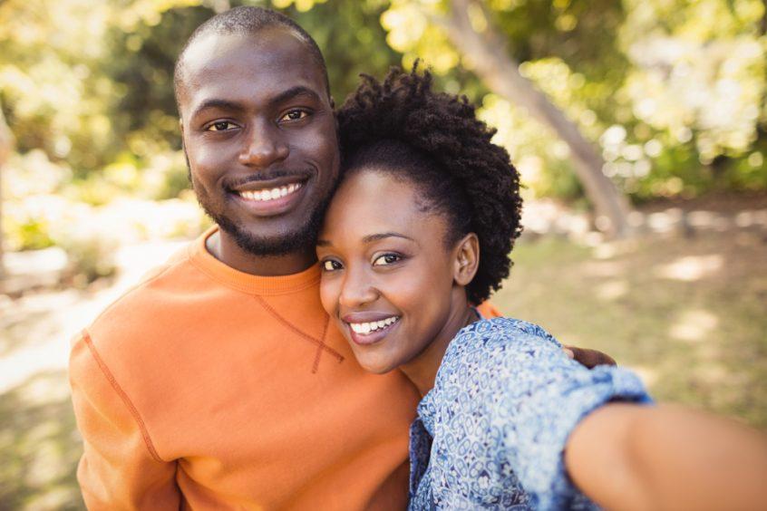 Happy couple smiling - Fruit-Powered